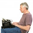 Elderly man is writing a letter — Stock Photo