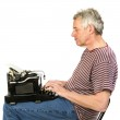 Elderly man is writing a letter — Stock Photo #2764127