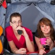 Young couple in a tent — Stock Photo