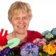 Elderly woman is gardening - Stockfoto