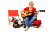 Playing guitar at the campground — Stock Photo