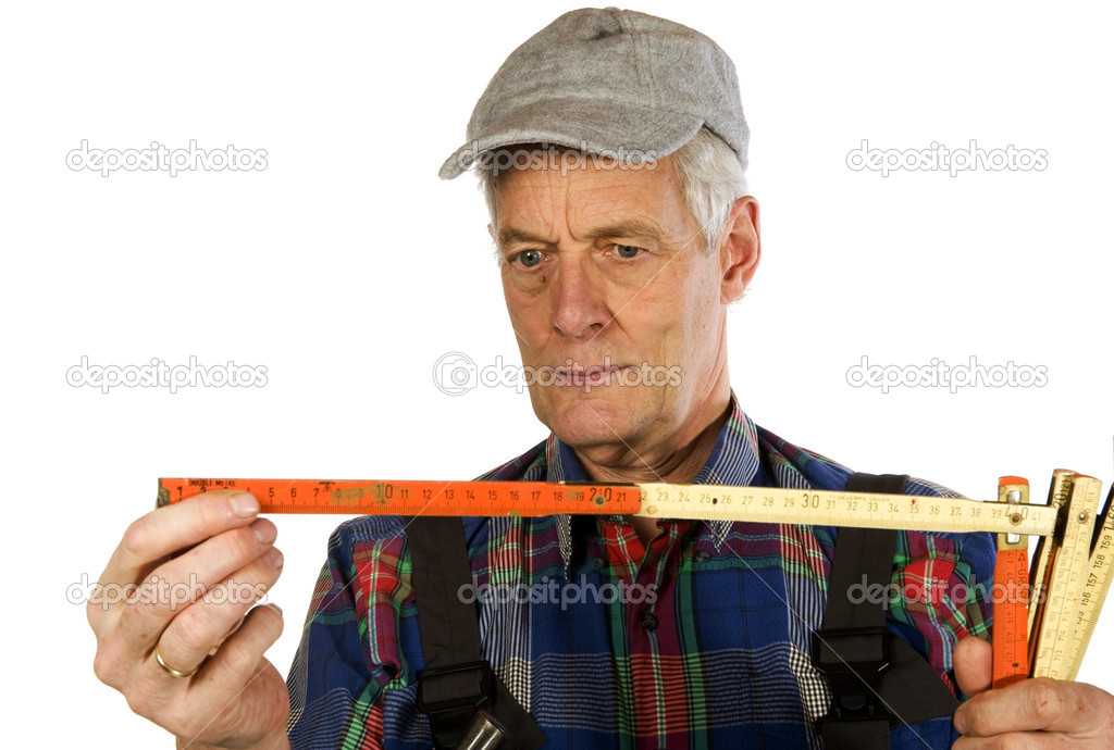 Measuring by an elderly man is knowing  Stock Photo #2764509