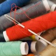 bobbins with colorful threads — Stock Photo
