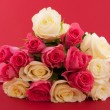 Bouquet roses on red — Stock Photo #2877856