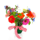 Bouquet flowers in green vase — Stock Photo