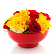 Red roses in yellow egg cups — Stock Photo #2881079