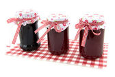 Glass pots with jam — Stock Photo