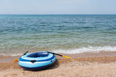 Beach with rubber boat — Stock Photo