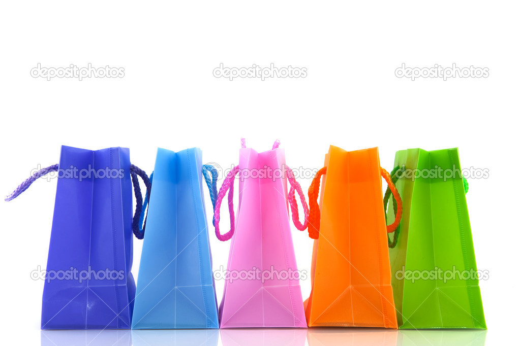 A row with colorful shopping bags with white background  Stock Photo #2882407