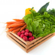 Wooden crate with vegetables — Stock Photo