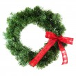 Green christmas wreath with red ribbon — Stock Photo