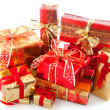 Many red and gold christmas presents - Stock fotografie