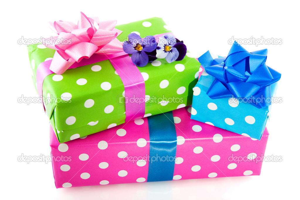 Colorful wrapped presents with ribbon dotted and stacked  Stock Photo #3019108