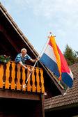 Hanging the Dutch flag — Stock Photo