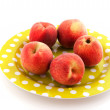 Nectarines on spotted plate — Stock Photo #3096661
