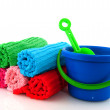 Rolled towels and playset — Stock Photo