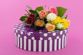 Colorful roses and birthday present — Stock Photo