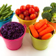 Fresh vegetables in colorful buckets — Stock Photo