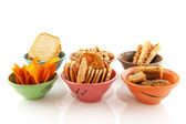 Bowls with salted snacks — Stock Photo