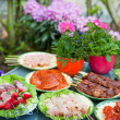 BBQ in the garden - Stock Photo