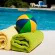 Towels and toys near the swimming pool — Stock Photo