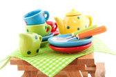 Wooden picnic table with crockery — Stock Photo