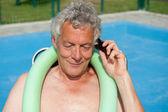 Senior man is having a telephone call — 图库照片