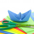 Folding a paper boat - Stock Photo