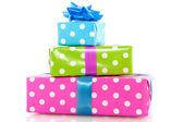 Pile colorful dotted presents — Stock Photo