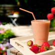 Strawberry smoothie in the garden — Stock Photo