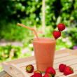 Strawberry smoothie in the garden — Stock Photo #3551342