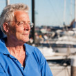 Stock Photo: Elderly man in harbor