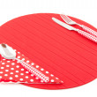 Place mat with red cutlery — Stock Photo