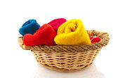 Rolled towels in basket — Stock Photo