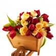 Wooden wheelbarrow with tulips — Stock Photo #3825379