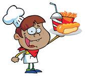 Ragazzo chef ispanica che trasporta un hot dog, patatine fritte e bibita — Foto Stock