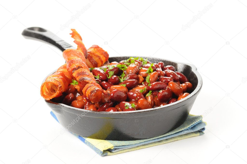 Baked beans and bacon served in a cast iron skillet.  Photo #3850207