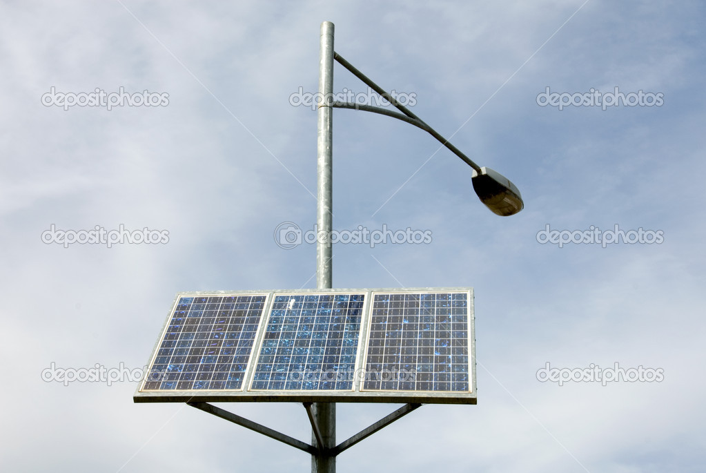 A bank of solar panels providing power for a street light  Stock Photo #2847130
