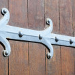 Stock Photo: Ornamented hinge on old church door