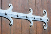 Ornamented hinge on old church door — Stock Photo