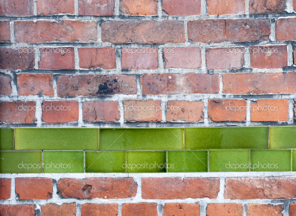 Old Red Brick Wall With Row Of Green Enamel Tiles Stock