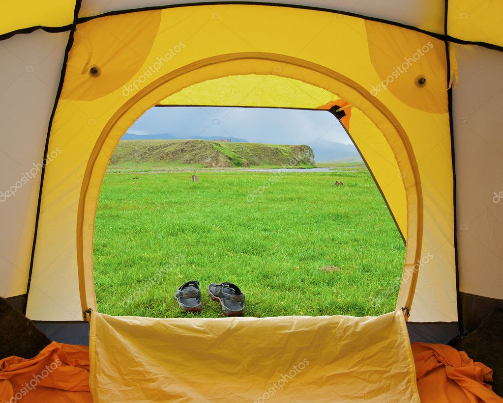 Kind from tent on lawn with green grass  Stock Photo #2835815