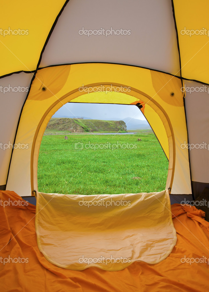 Tent standing on a grass in mountains — Stock Photo #2835900