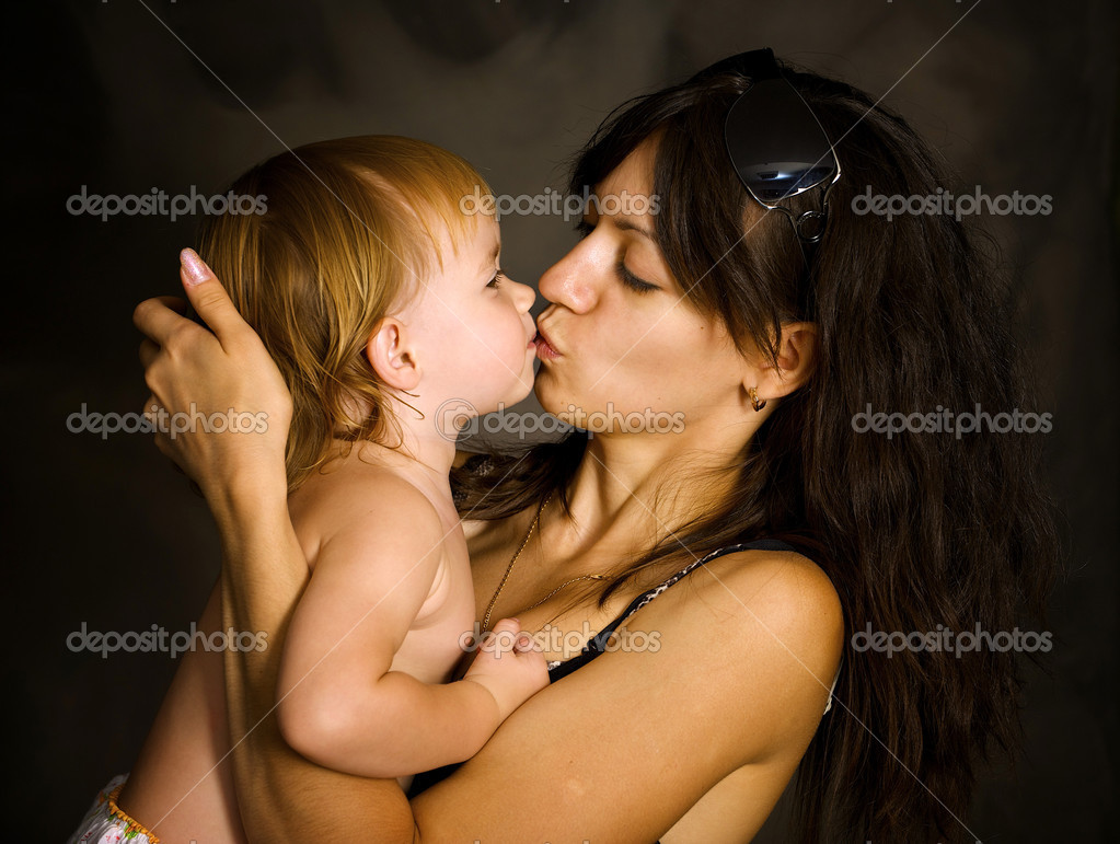 Excellent kisses of mother and daughter