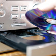 Loading or putting CD into player — Stock Photo