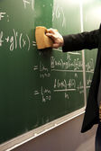 Erasing a blackboard — Stock Photo