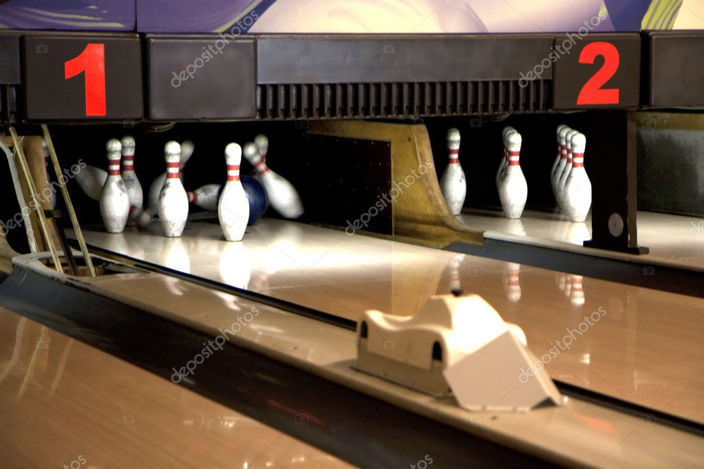 Playing bowling on multiple tracks — Stock Photo #3306133