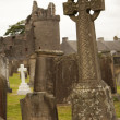 Celtic cross at a churchyard — Stock Photo