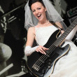 Bride with guitar. — Stock Photo