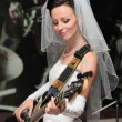 Bride with guitar. — Stock Photo #3546420